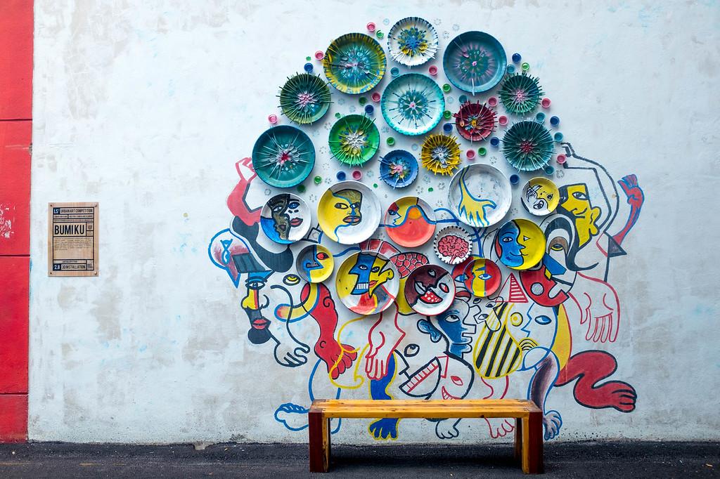 Unknown Artist - Plates on a wall street art