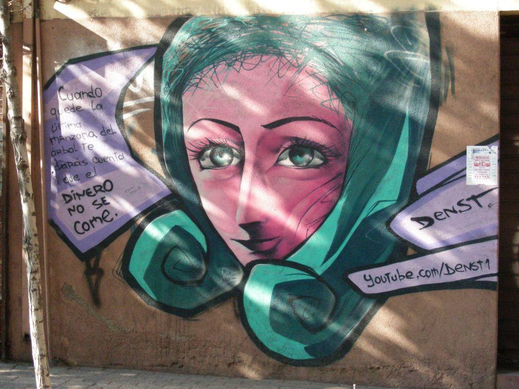 street art piece by 'Denst' in the San Pablo neighborhood