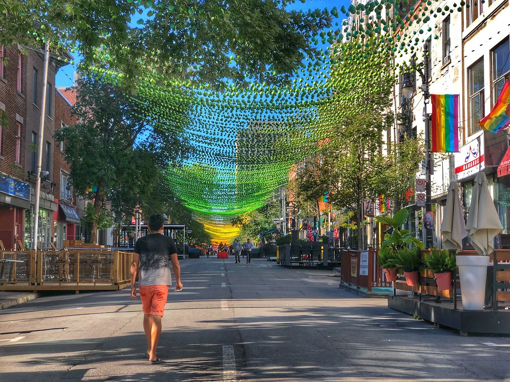Colourful rainbow of balls hanging in the Village, Montreal