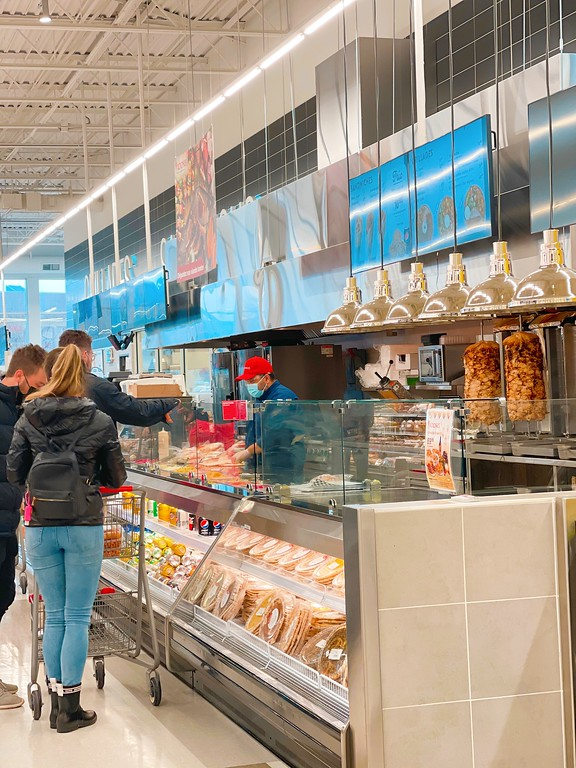 Buying shawarma wraps inside Marché Adonis in Quebec City