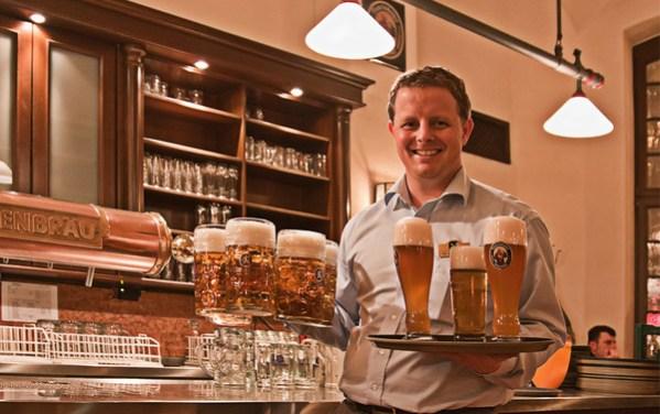 Serving beer at the Löwenbräu brewery, Munich, Germany