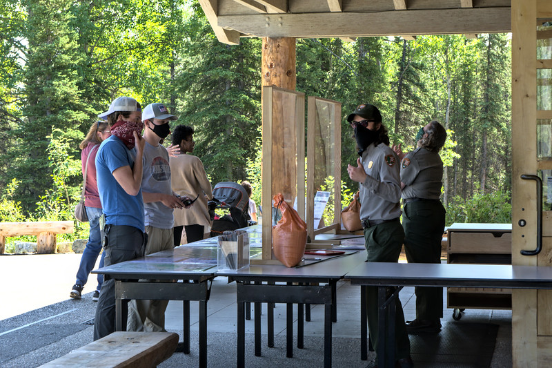 Park visitors speak with Denali National Park Rangers and staff outside the Visitor Center which is closed for the 2020 summer season due to COVID-19.