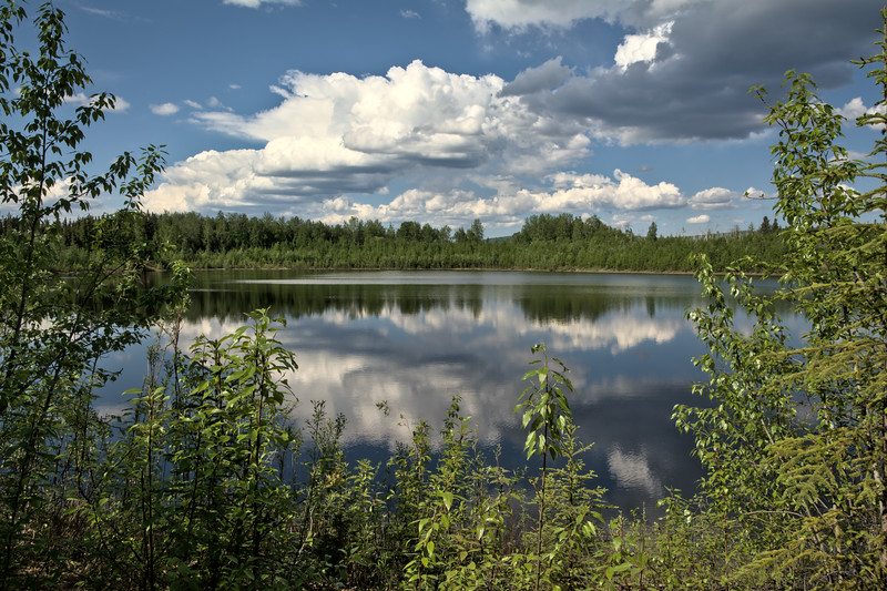 View of clouds over Wander Lake at the Wedgewood Wildlife Sanctuary in Fairbanks, Alaska