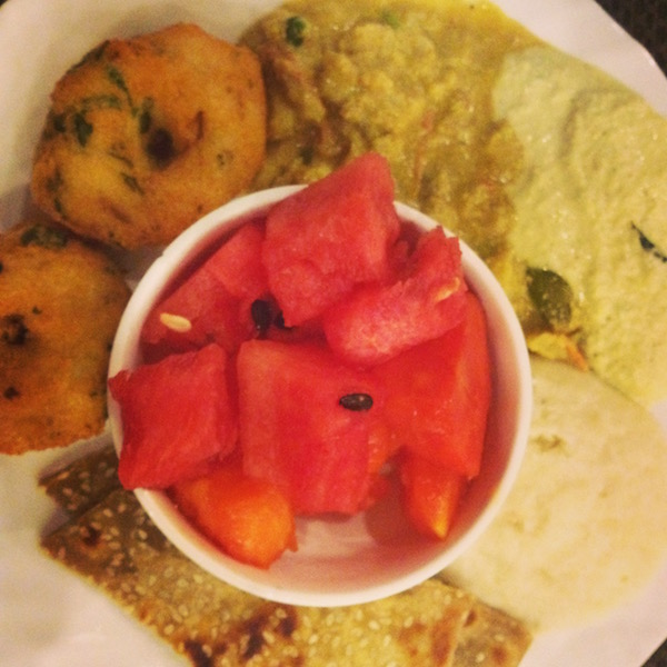 Indian breakfast with fruit and other food