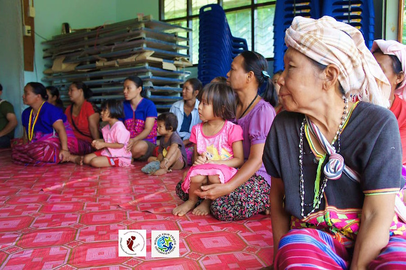 women listening to a WEAVE presentation in Thailand