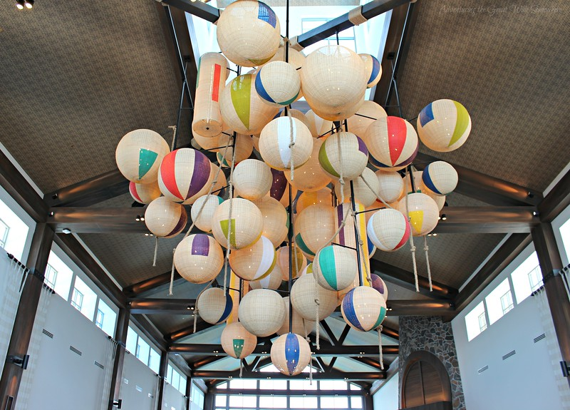 Paper lanterns anchor the lobby space.