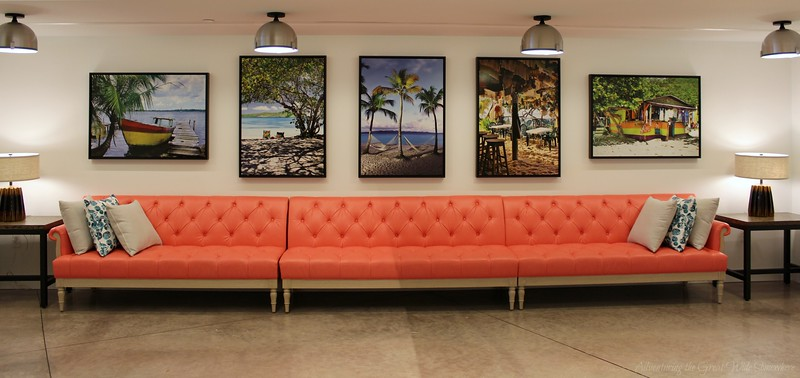 A fun trio of lounging benches and tropical prints in the waiting area for the Amatista Cookhouse