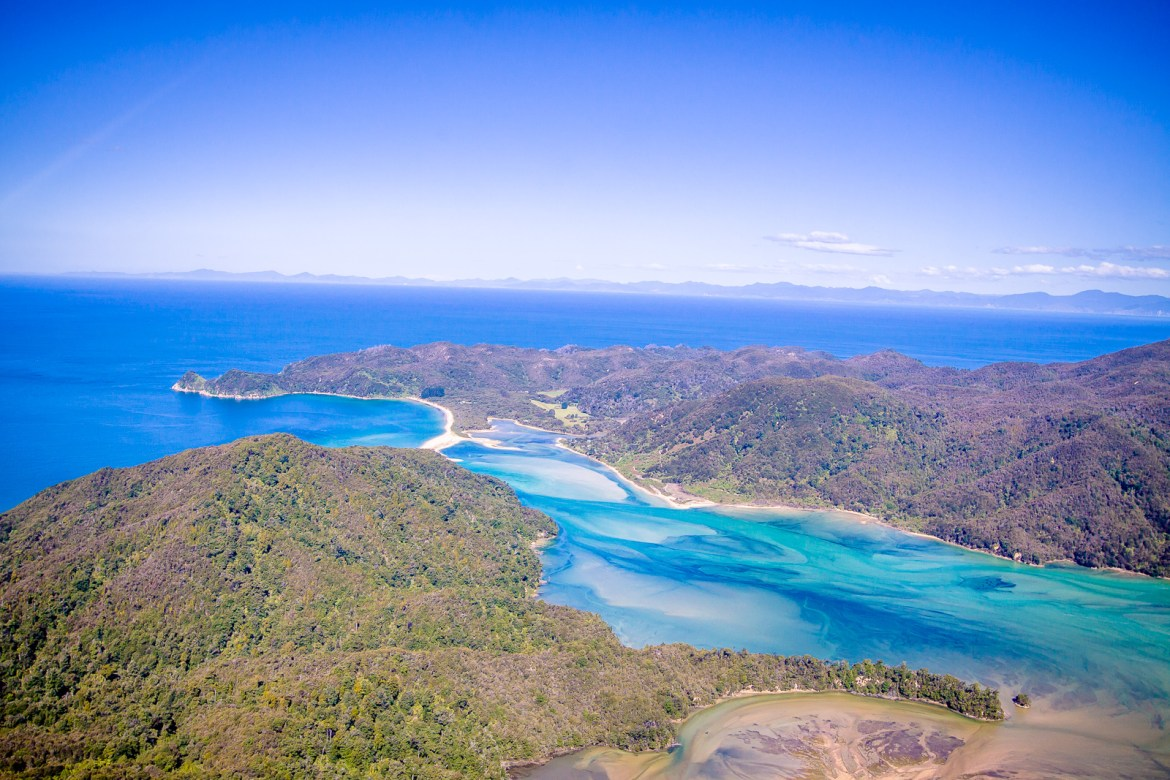 For a unique perspective in New Zealand, don't miss an opportunity to see Abel Tasman National Park from the air! Check out the amazing spots we were able to see from our helicopter tour of this stunning spot. | www.eatworktravel.com - The luxury, adventure couple!
