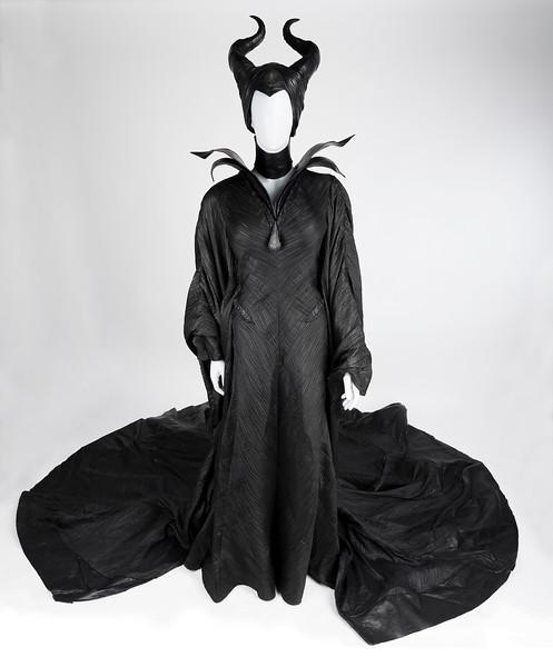 "Maleficent - costume, black ""Christening"" dress, black collar, black corset, black boots, black headdress w/ horns, black spine ring (08456). Change #2, Sc: 88-89"