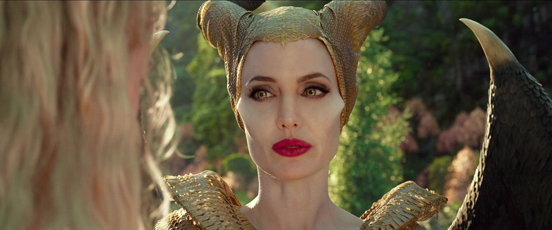 Elle Fanning is Aurora and Angelina Jolie is Maleficent in Disney's MALEFICENT: MISTRESS OF EVIL.