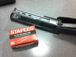 Empty stapler, and box of Staples-branded paper clips, misleadingly labeled