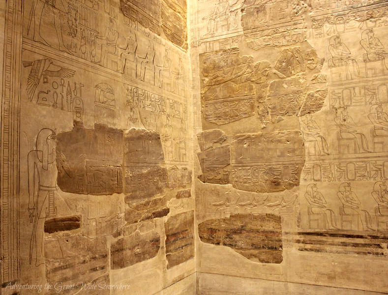 A wall of ancient Egyptian hieroglyphs at the Louvre