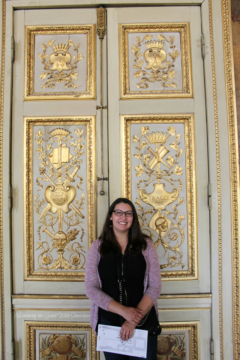 Myself standing in front of two beautiful gold and ivory doors