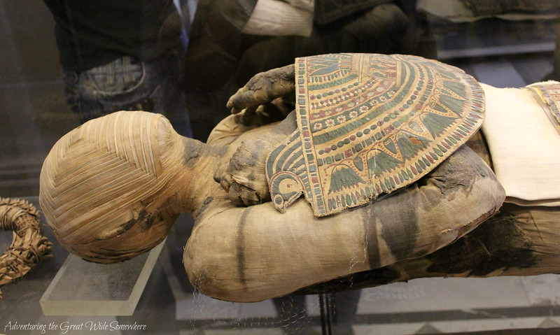A real, actual mummy, laid on his back and put on display inside the Louvre