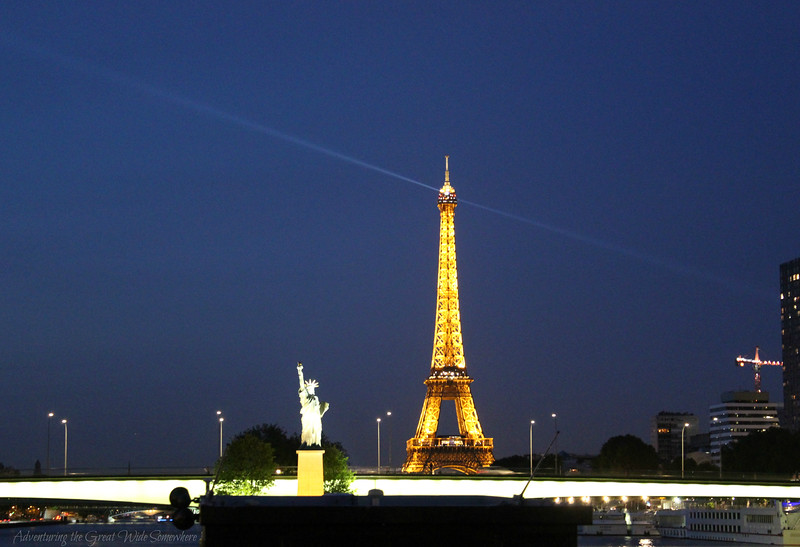 The Eiffel Tower and the replica of the Statue of Liberty, seen from our Seine dinner cruise