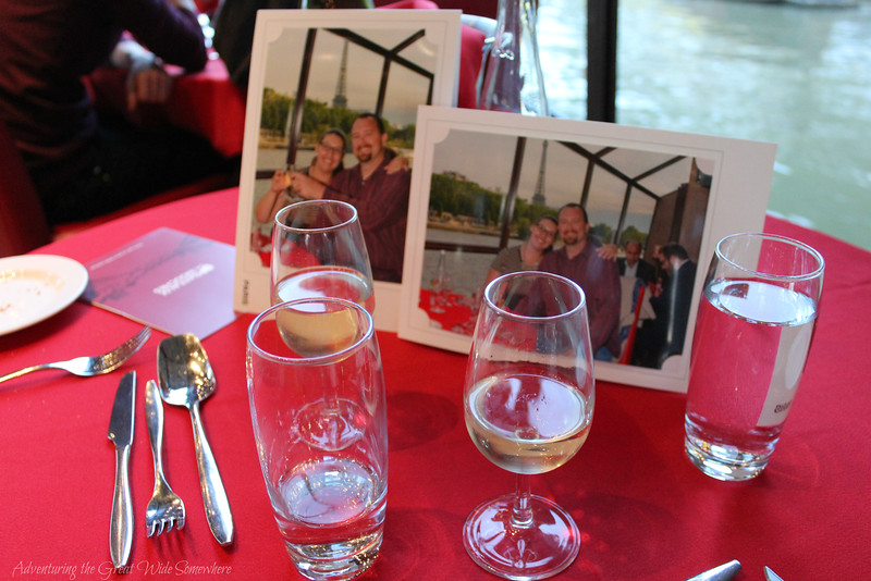 Our table on the Bateaux Mouches dinner cruise, with champagne, water and souvenir photos