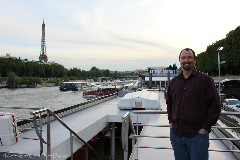Dan on the top deck of our Bateaux Mouches dinner cruise, docked before departure