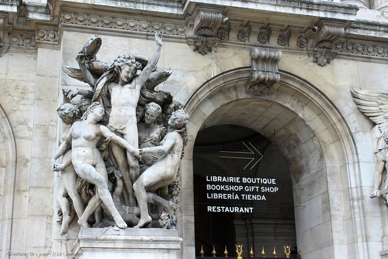 Statues adorn the exterior street view of the Palais Garnier in Paris.