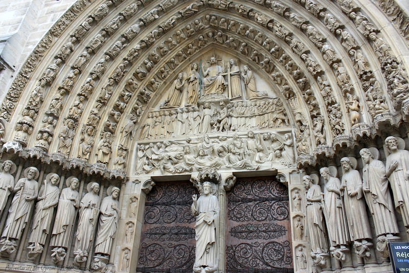 The Massive Wood Doors and Carved Statuettes that Decorate the Entrance to Notre Dame Cathedral in Paris