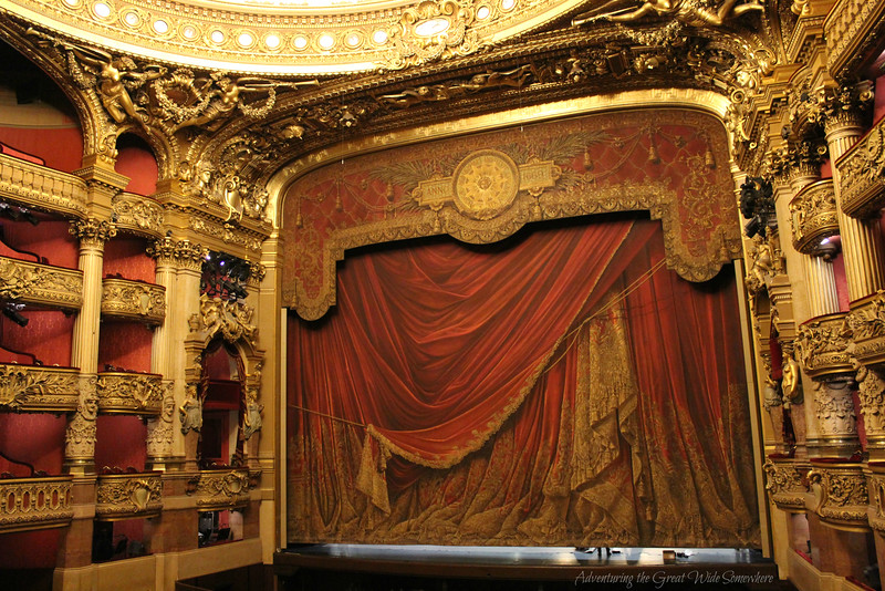 The red and gold theater of the Palais Garnier gives off some serious Phantom of the Opera vibes