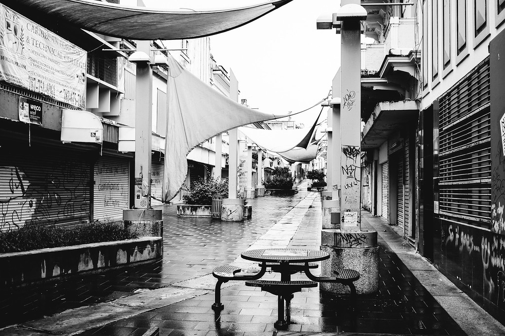empty street in black and white while raining