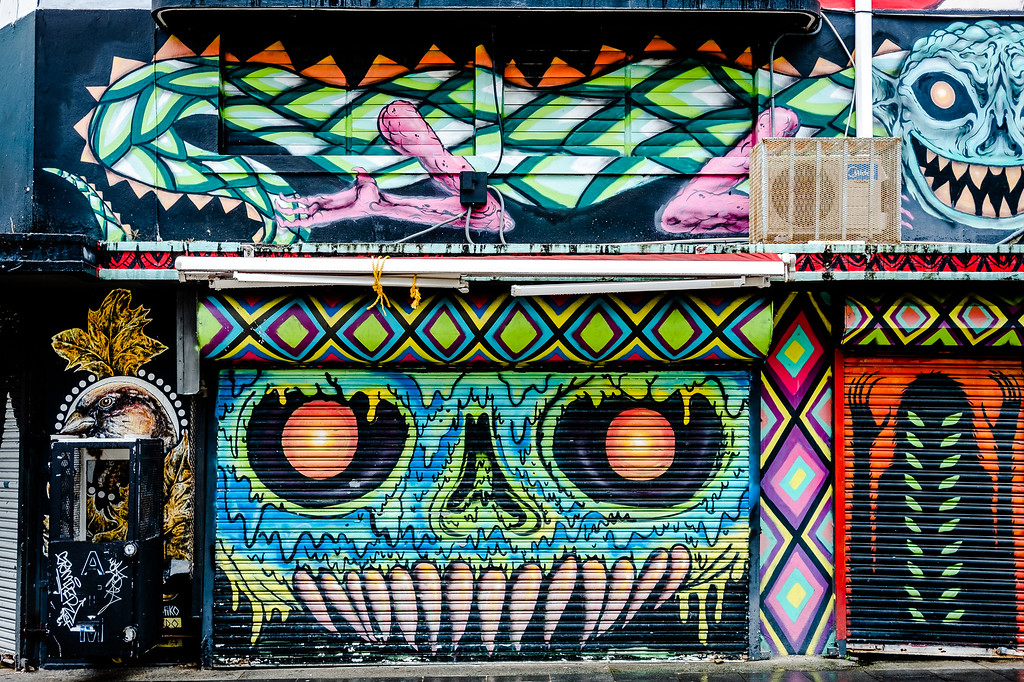 graffiti of aliens, beautiful birds, lizards, exotic creatures