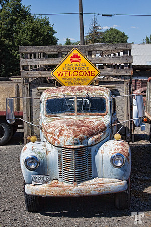 Dave's Old Truck Rescue sign and old rusty truck in Spargue, Washington