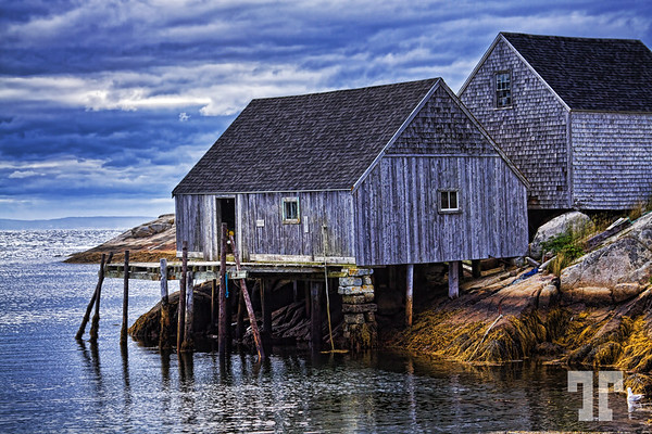 Fisherman's shacks at low tide in Peggy's Cove, Nova Scotia