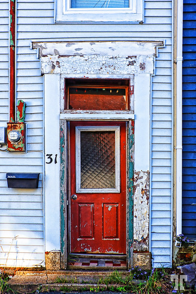 Red deteriorated door in St. John's Newfoundland