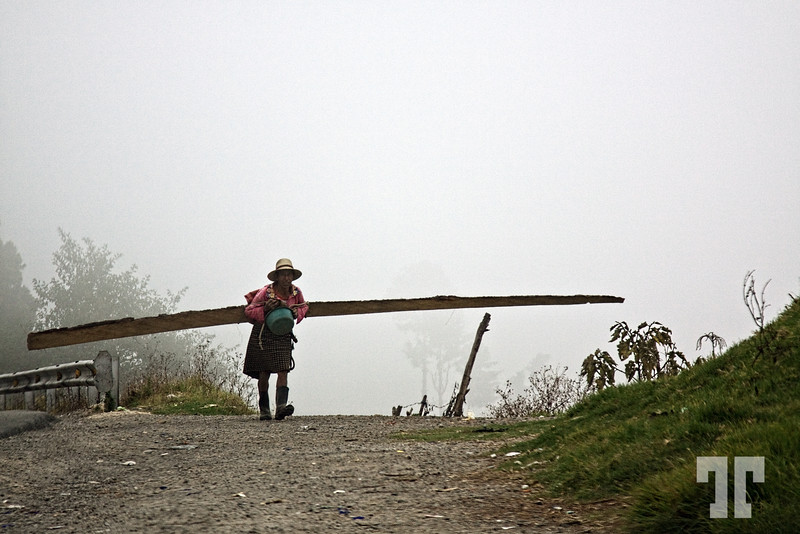 Woman carrying wood in the rural Guatemala