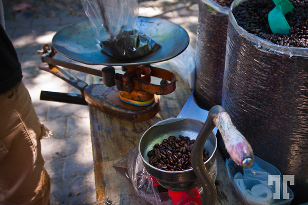 Grinding, and weighting fresh coffee in Ajijic market, Mexico