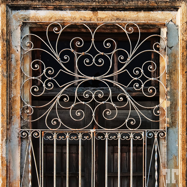 Rusted artistic door screen in Merida
