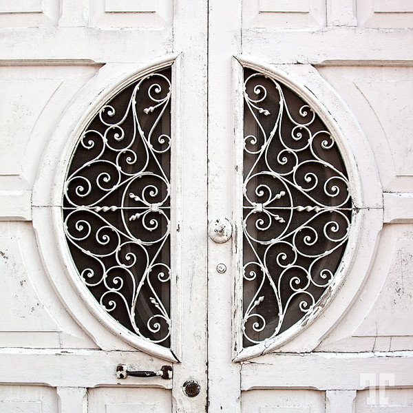 Filigree artwork on door screens in Merida, Mexico