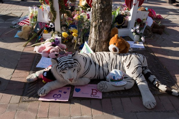 A beautiful stuffed white tiger is part of the Boston Marathon bombing victims memorial in Boston's Copley Square - April 25, 2013