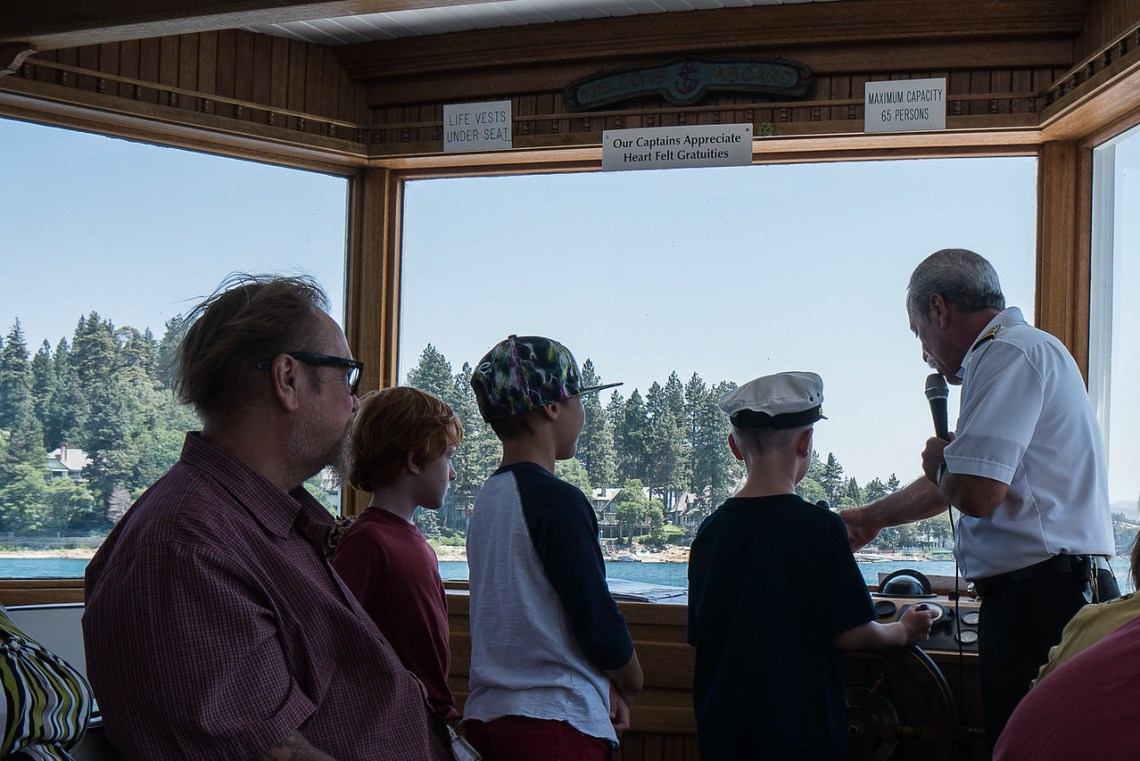 Children line up to take a turn steering the Arrowhead Queen
