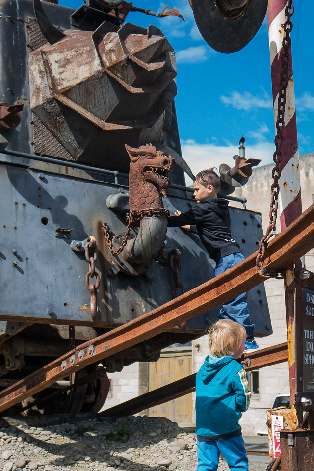 Young children climbing on steampunk locomotive