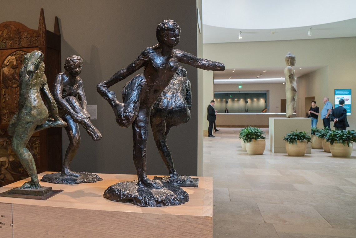 Degas bronzes with security men in the background
