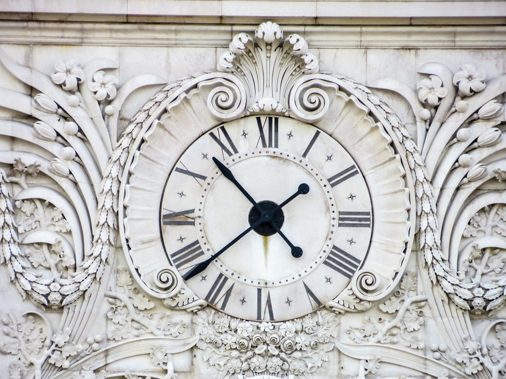 Your first solo trip should be Portugal because of decorative architecture like this clock.