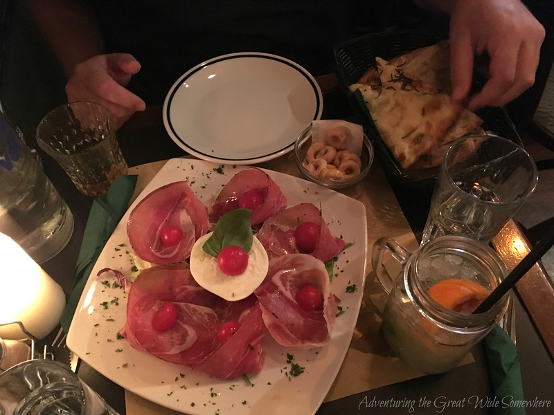 Charcuterie, flatbread, and drinks at Ombre Rosse in Rome's popular Travestere neighborhood.