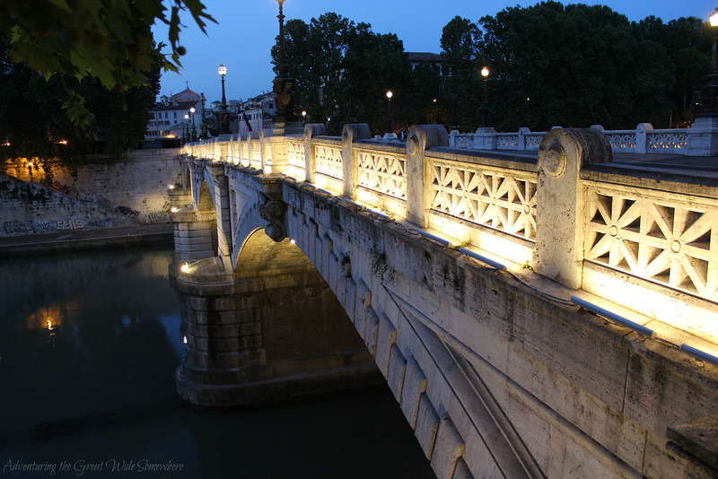 Bridge Over The Tiber River in Rome Seen at Night