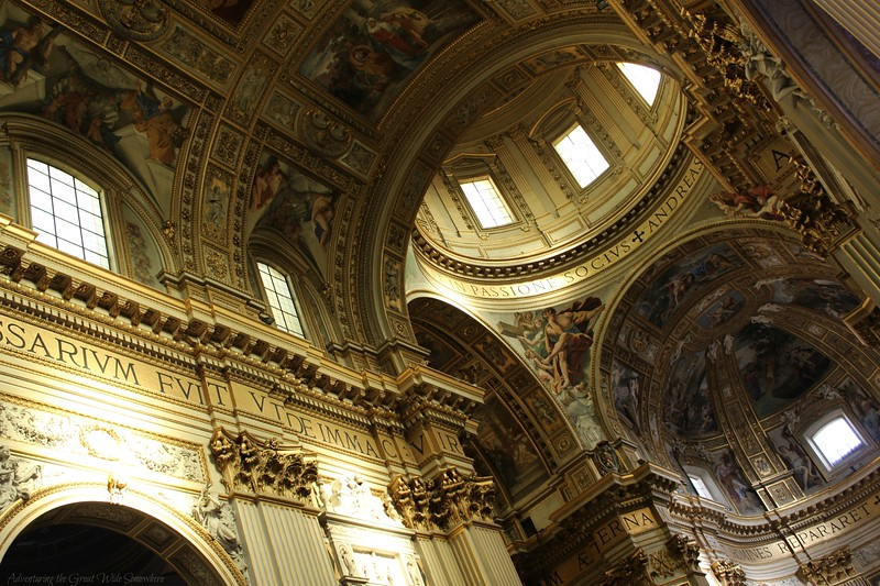Impressive view of the sculpted and painted ceilings of the Church of Sant'Andrea della Valle in Rome, Italy