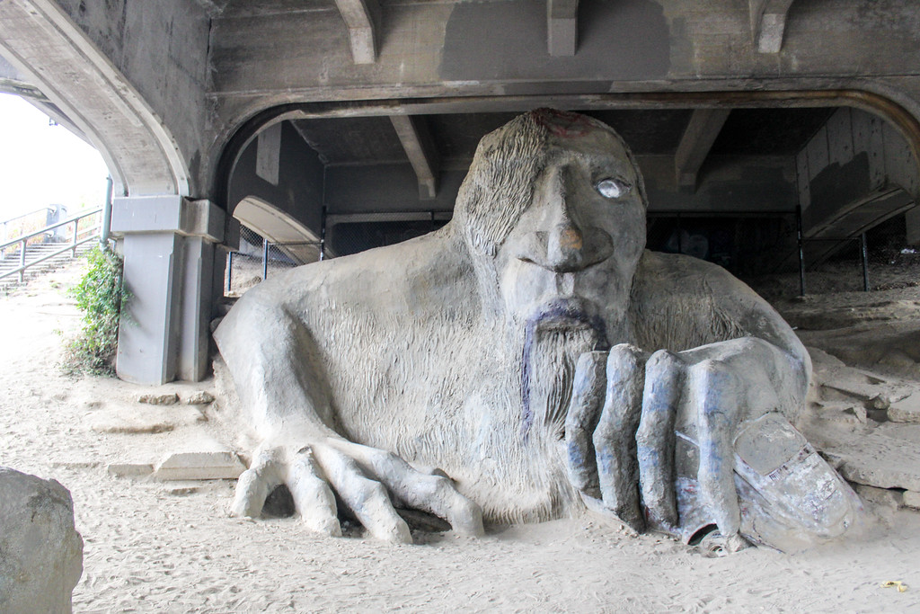 are you a solo female travel seattle? visit the fremont troll!