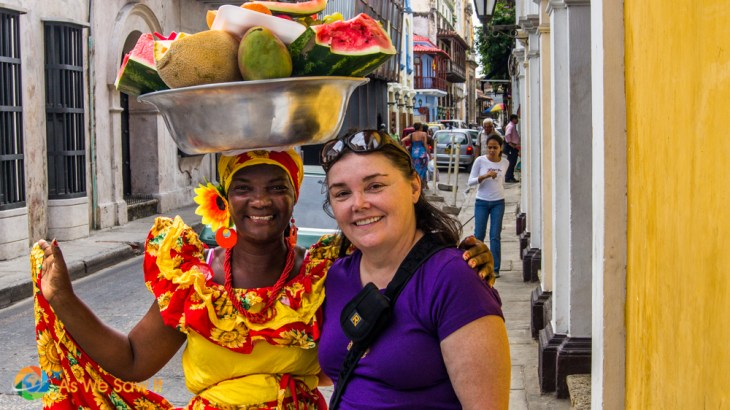 Two very warm smiles as colorful characters are ready to enjoy some fresh fruit in the UNESCO walled city of Cartagena.