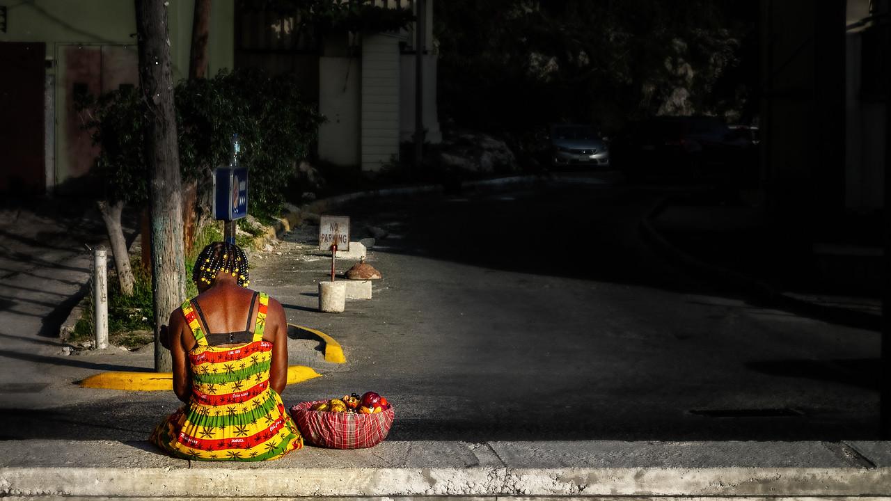 Colorful Jamaican peddler selling fruit