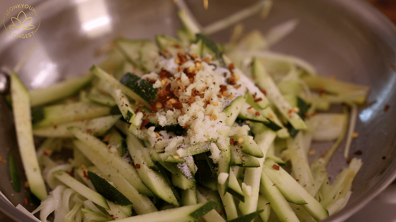 Summer Pasta with Zucchini Recipe Vegan - Season with salt, pepper and red pepper flakes
