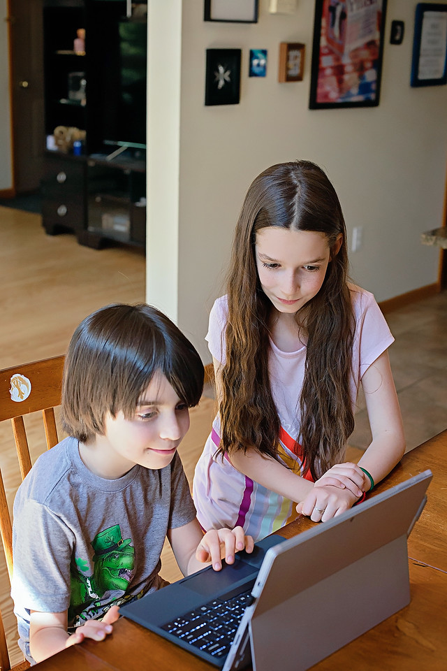 kids playing Prodigy on computer