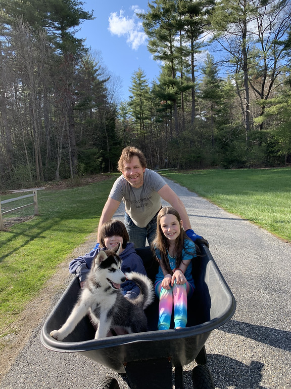 kids and puppy wheelbarrow rides