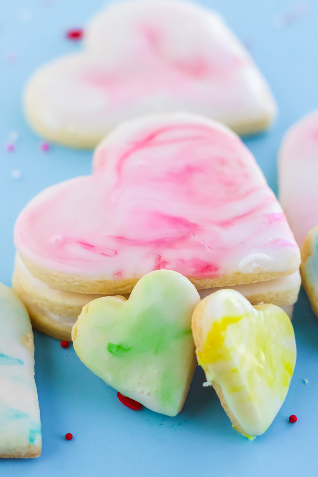 These Marble Iced Valentine's Day Cookies are an easy recipe with a delicious and fun royal icing on top. Make golden cookies and ice them