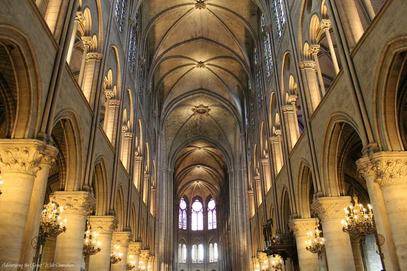 The nave of Notre Dame de Paris, seen from between the two front doors.