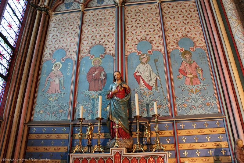 A colorful chapel inside Notre Dame Cathedral, featuring an an altar with a statue of Jesus Christ.